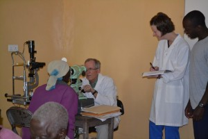 Sarah, Darrell, and Dr. Ozzie at the eye clinic.