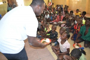 Darrell feeding the children at the OVC