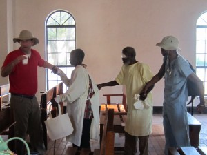 Pastor John and Frank leading the blind
